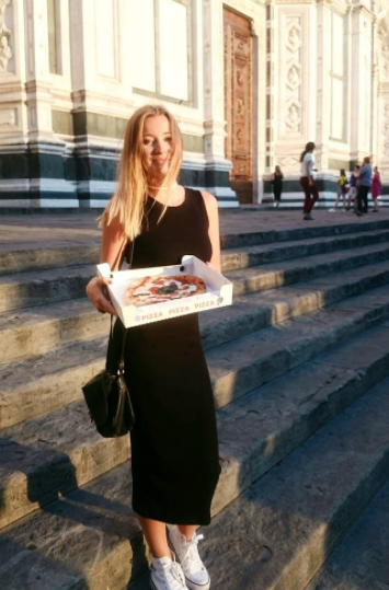 Girl with pizza in front of Santa Croce Church