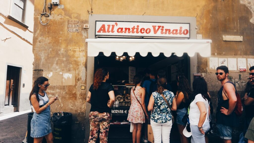 People waiting in a line to All'Antico Vinaio in Florence