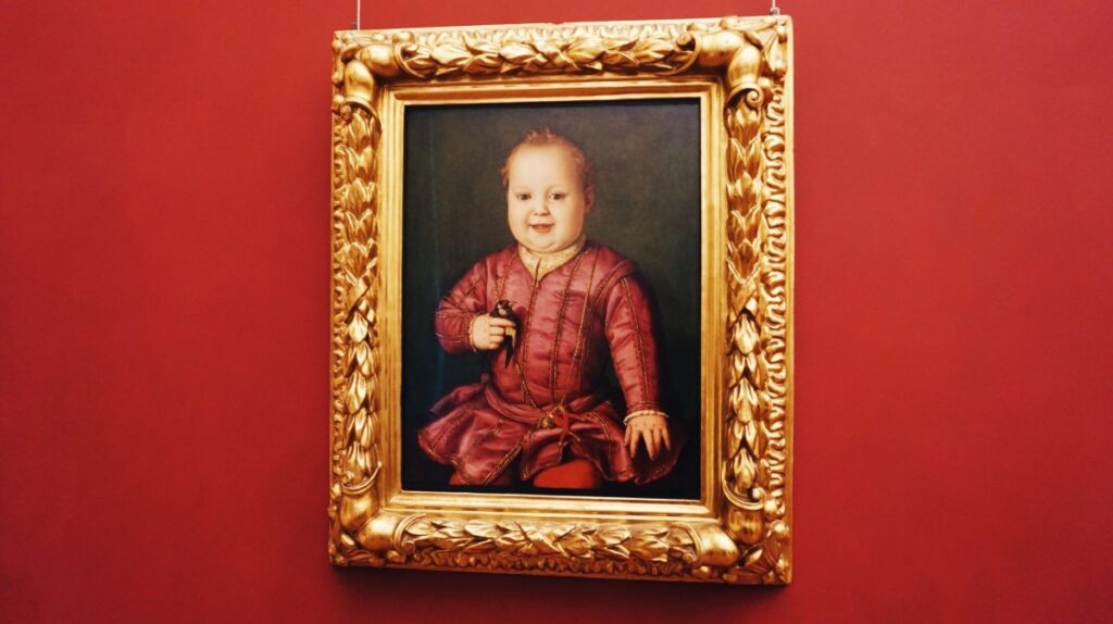 A painting with a baby in Uffizi Gallery